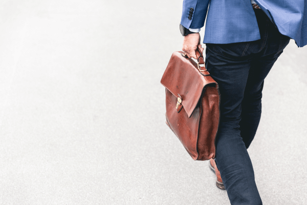 Image of person walking away with briefcase